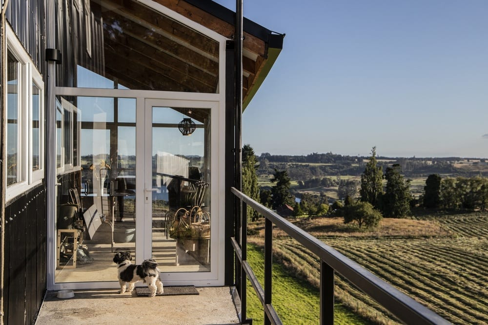 Large glass windows allow full, unrestricted views of the breathtaking landscape.