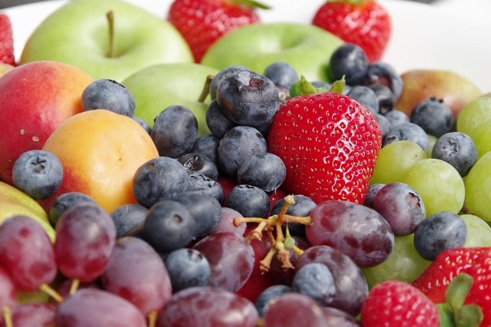You can ripen fruit quicker by placing them in a container and completely covering them with uncooked rice.