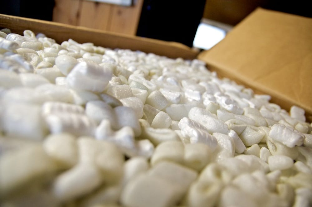 Filling the bottom half of large gardening pots and containers with packing peanuts saves you money